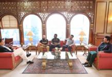 Peshawar Zalmi officials with PM Imran Khan
