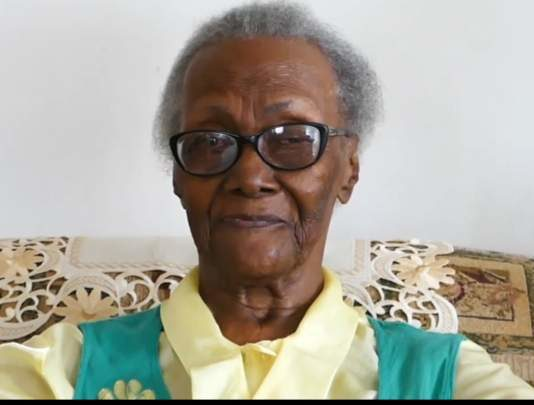 CWI: West Indies Superfan reaches 100 and raises her bat in fine style